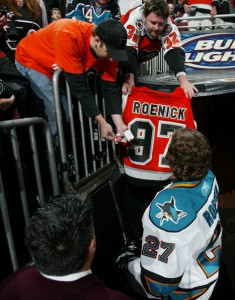 US Hockey Hall of Fame Inductee Jeremy Roenick signs autographs for fans.Hockey