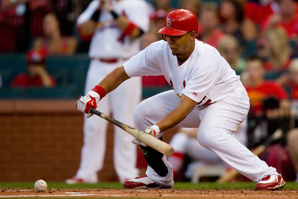 Jon Jay lays down a bunt wearing the Nike Air Max MVP.