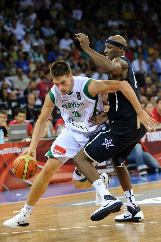 Gasper Vidmar goes to basket as Lamar Odom tries to block him