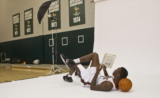 Larry Sanders of the Milwaukee Bucks catches up on his favorite book.