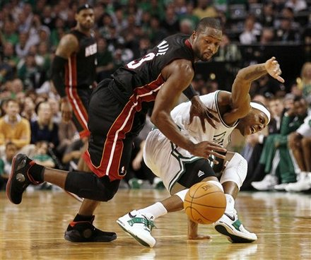 Dwyane Wade in the Air Jordan 2010 gives a gentle push to Paul Pierce in his latest Nike Air Legacy PE