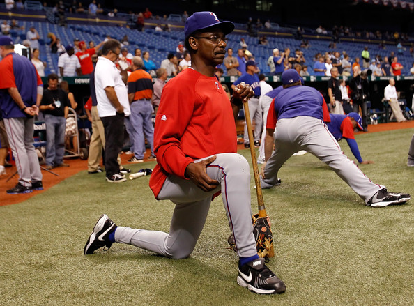 Manager Ron Washington stretches pre-game wearing the Nike Air Diamond Trainer.