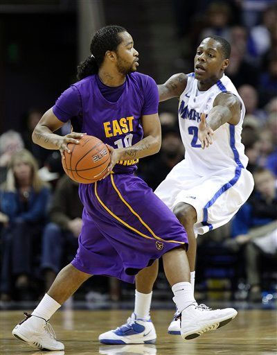 "Brock Young of East Carolina looks to pass wearing the Jordan Retro 12 ""Rising Sun"""