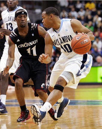 "Corey Fisher of Villanova protecting the ball wearing the ""Flint"" Jordan Retro 13."