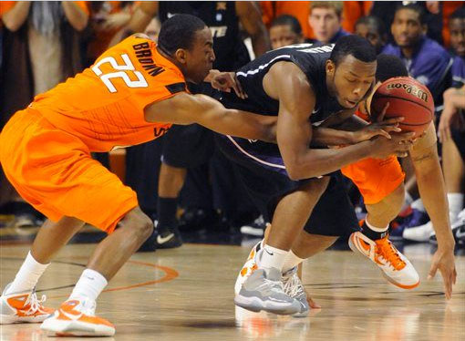 Jacob pullen of Kansas State fights off defenders in the Cool Grey Jordan Retro 11.