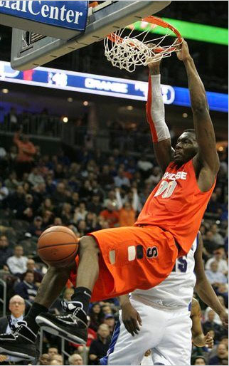 Rick Jackson of Syracuse dunks wearing the Jordan Retro 2.