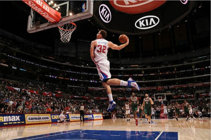 Blake Griffin warms up for the dunk contest with a windmill jam in the Nike