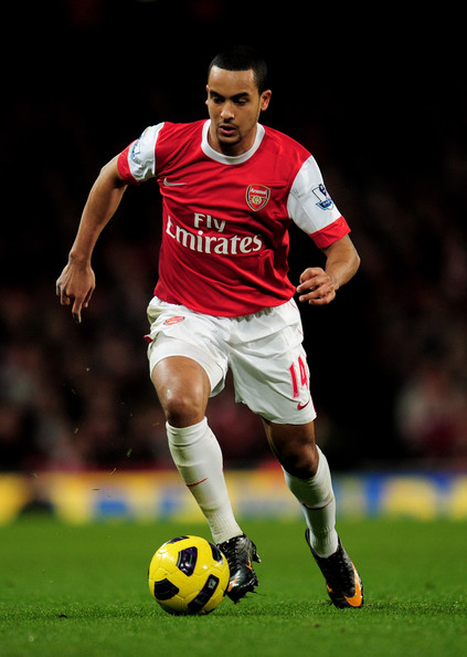 Theo Walcott of Arsenal wearing Nike Mercurial soccer cleats.