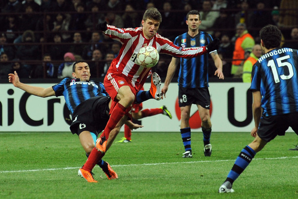 Thomas Muller of Bayern Muenchen wearing the brightly color adidas F50 adiZero.