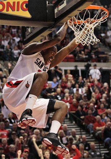 Jamaal Franklin of San Diego State throws down a dunk in the Jordan Retro 13.