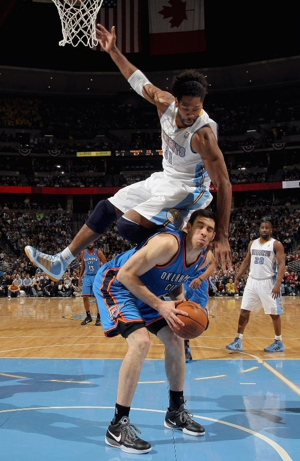 Nene in the adidas adiPURE gives Nick Collison an uncomfortable moment.