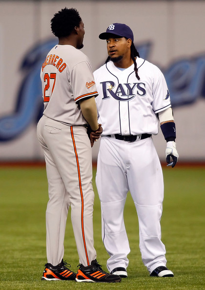 Vlad Guerrero chats with Manny while wearing his adidas Diamond King PE.