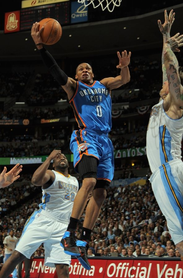 Russell Westbrook soaring in the Nike Zoom Hyperfuse PE.