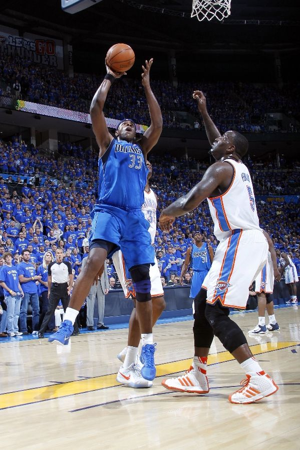 Brendan Haywood in the Zoom Hyperfuse, shoots over Kendrick Perkins in the adidas Pro Model.
