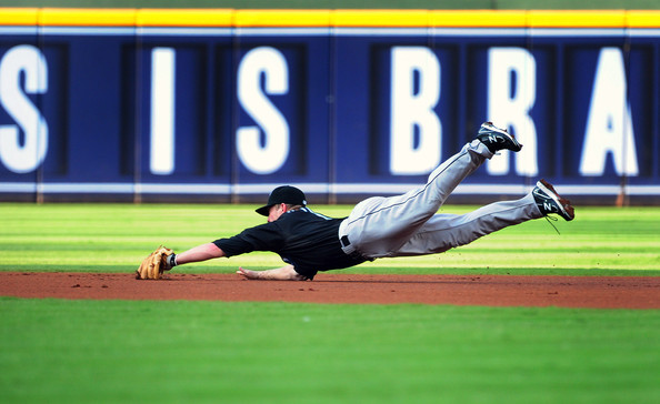 Aaron Hill of the Blue Jays makes a nice play in his New Balance cleats.