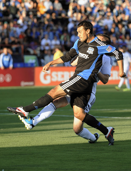 Chris Wondolowski of the San Jose Earthquake takes a shot wearing Nike soccer cleats.