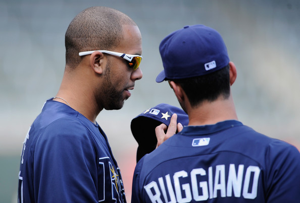 David Price admires his All-Star pin with Justin Ruggiano.