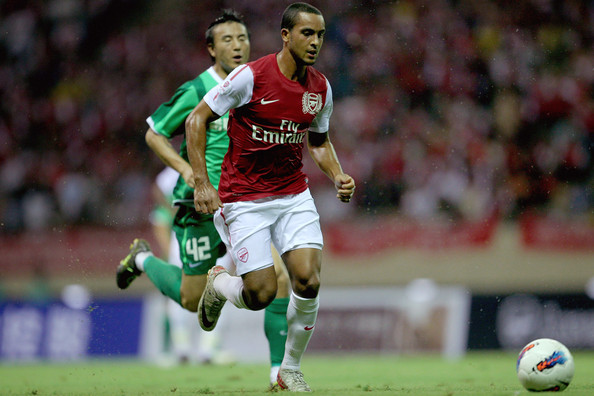 Theo Walcott of Arsenal makes a run wearing Nike soccer cleats.