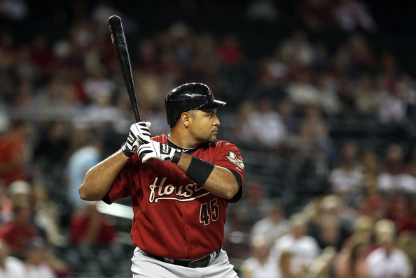 Carlos Lee prepares for the pitch wearing Franklin batting gloves.