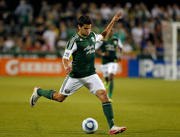 Sal Zizzo of the Portland wearing Nike Mercurial cleats, takes a shot on goal against Chivas USA.