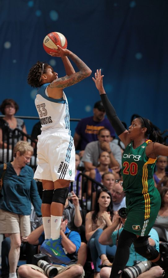 Seimone Augustus shoots a jumper in the Nike Zoom Hyperfuse 2011.