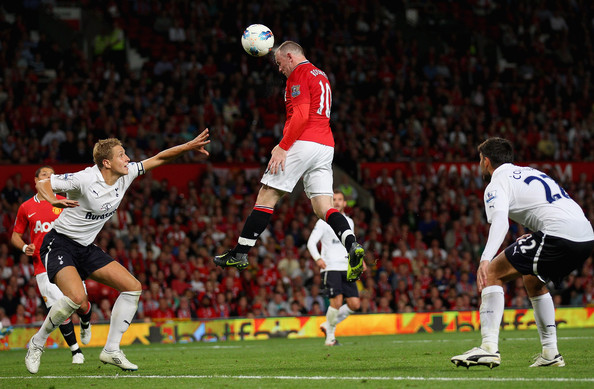 Wayne Rooney elevates in his Nike cleats to put in a header for Manchester United.Wayne Rooney elevates in his Nike cleats to put in a header for Manchester United.