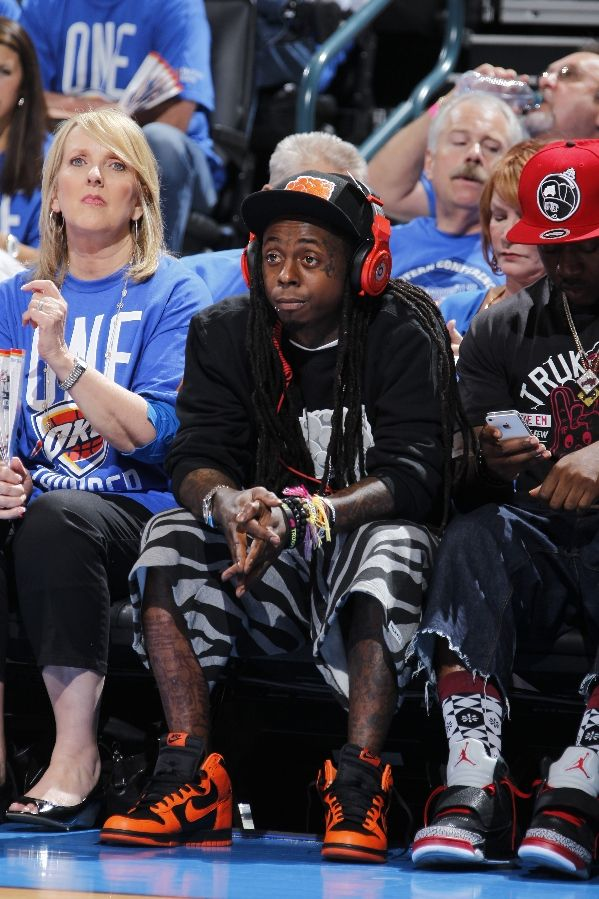 Lil' Wayne wearing Nike Dunk High Black Orange