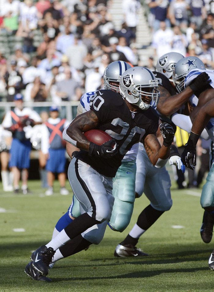 Darren McFadden wearing Nike Alpha Talon Elite