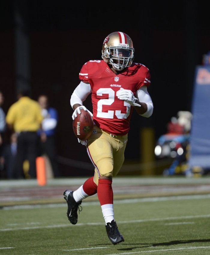 LaMichael James wearing Nike Vapor Talon Elite Low