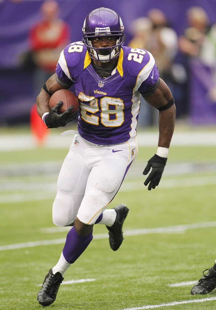 Adrian Peterson wearing adidas adiZero 5-Star Mid Blackout