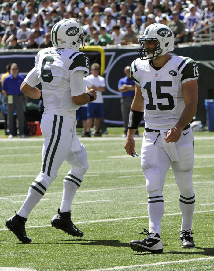 Mark Sanchez wearing Nike Lunar Superbad Pro TD; Tim Tebow wearing Nike Alpha Speed TD