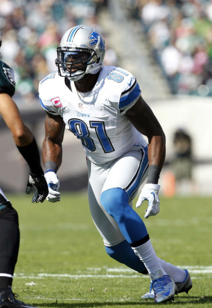 Calvin Johnson wearing Nike Vapor Talon Elite Low