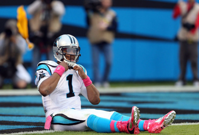 Cam Newton wearing Under Armour Cam Highlight Pink
