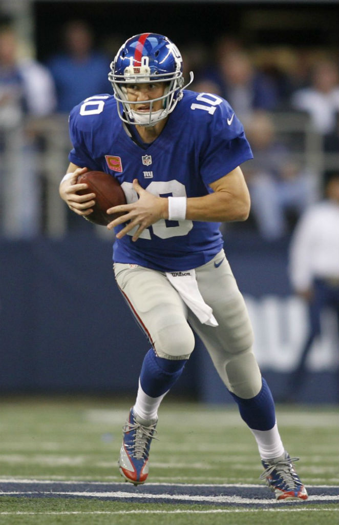 Eli Manning wearing Reebok Custom Cleats