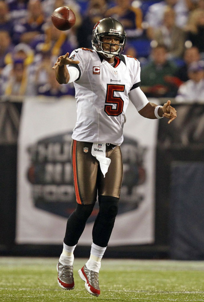 Josh Freeman wearing Air Jordan IX 9 Turf PE