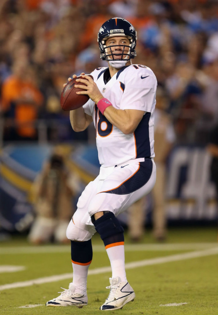 Peyton Manning wearing Reebok Football Cleats