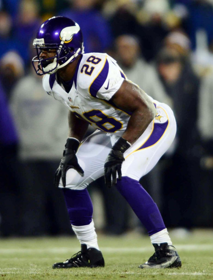 Adrian Peterson wearing Nike  Vapor Talon Elite 3/4