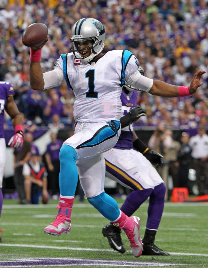 Cam Newton wearing Under Armour Football Cleats Pink