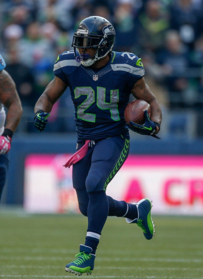 Marshawn Lynch wearing Air Jordan 12 XII PE Cleats