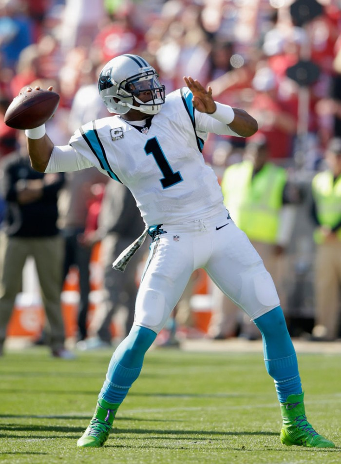 Cam Newton wearing Under Armour Highlight '14 Alter Ego
