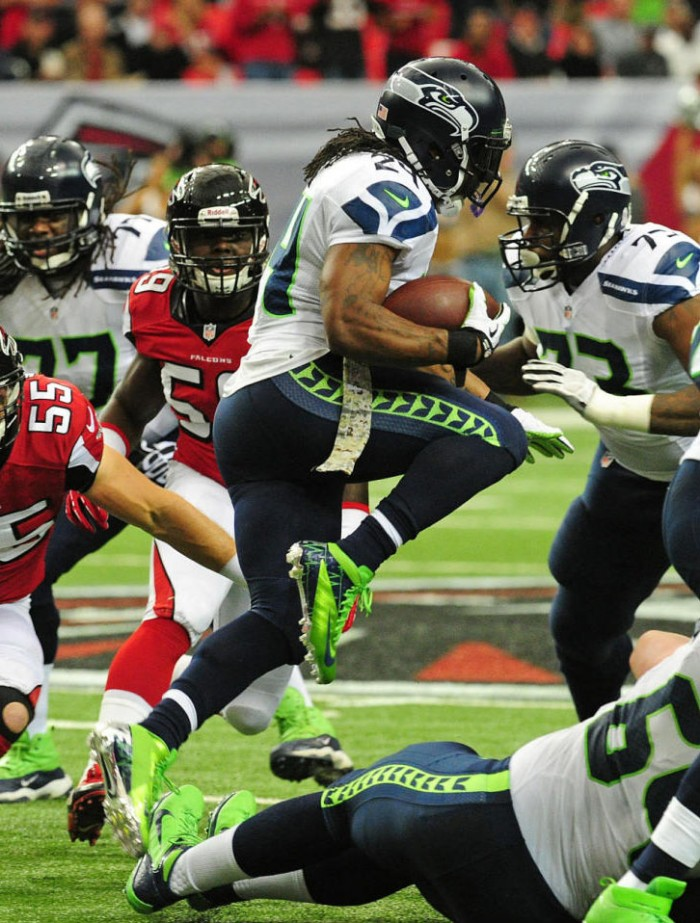 Marshawn Lynch wearing Nike Vapor Talon Elite 3/4 PE