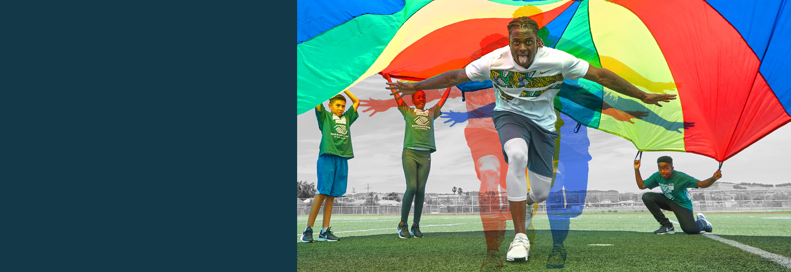Davante running under colorful parachute