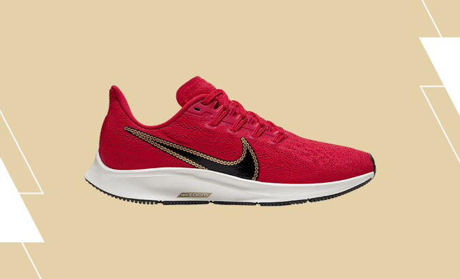 Women's Nike Air Zoom Pegasus 36 in University Red colorway with black Swoosh outlined in gold sequins.