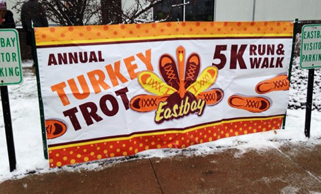 Eastbay Turkey Trot signage outside in the snow.