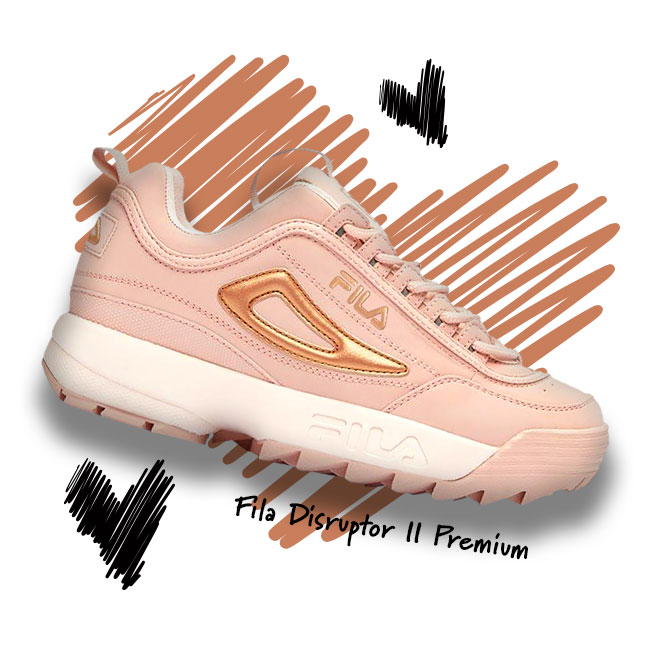 A FILA Disruptor II Premium sneaker in the Spanish Villa/Silver Peony/Dusty Pink colorway in front of a scribbled heart.